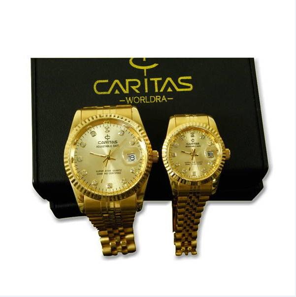 Đồng hồ cặp dây thép mạ vàng Caritas đính kim cương.